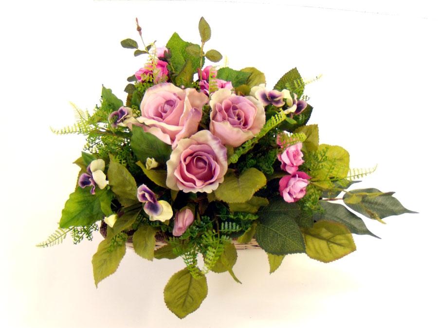 Composizione funeraria di fiori artificiali